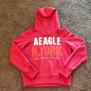 Never been worn! AE Coral hooded sweatshirt.